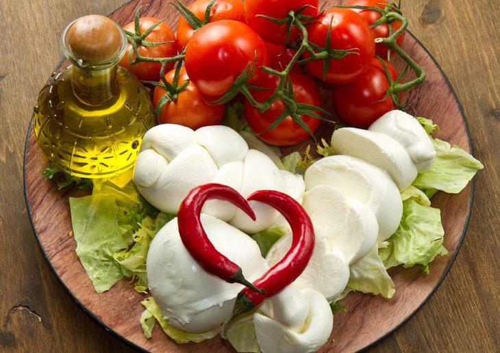11266323 - a fresh italian mozzarella with tomato