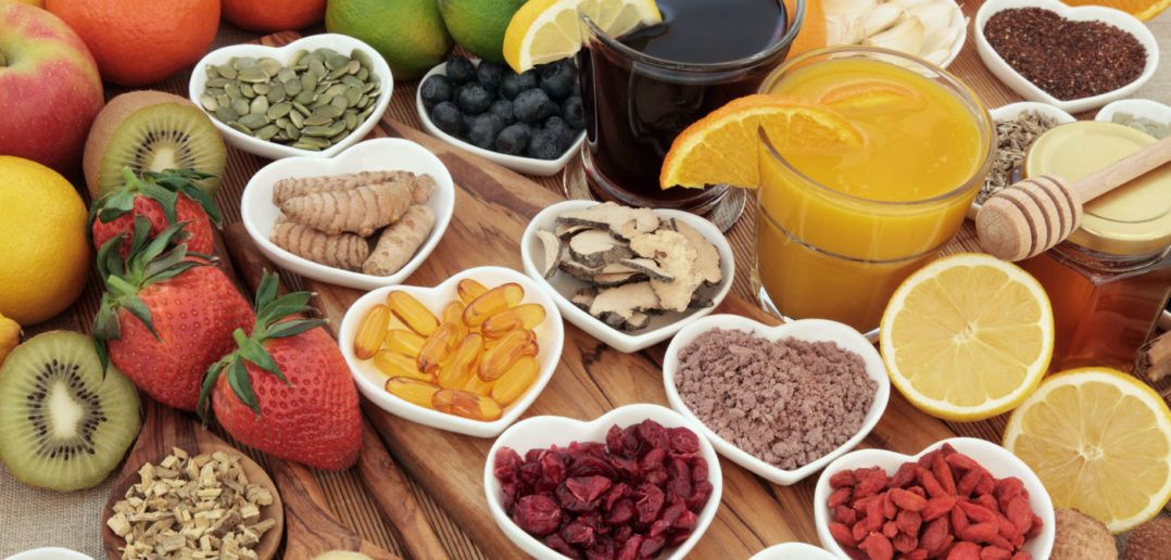 46640030 - super food selection for cold and flu remedy including foods high in vitamic c and antioxidants with herbal medicine and supplement capsules.