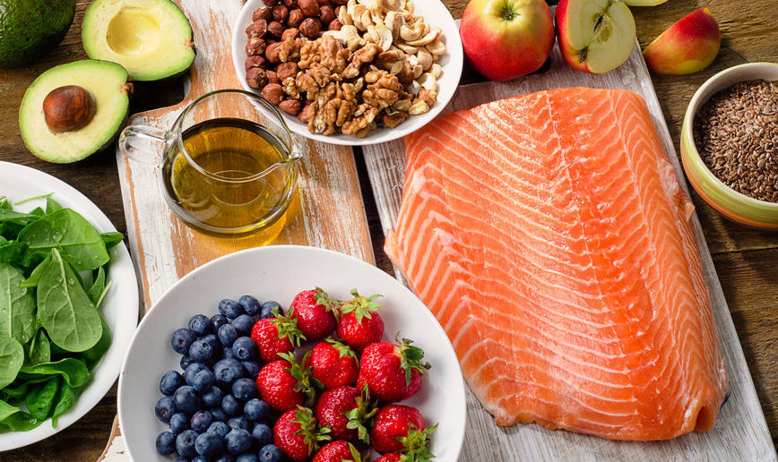 60838216 - foods for healthy heart on wooden background. top view