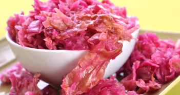 Closeup of beautiful pink naturally cured fermented sauerkraut on yellow background