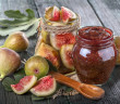 fresh homemade fig jam with fresh figs on an old wooden table