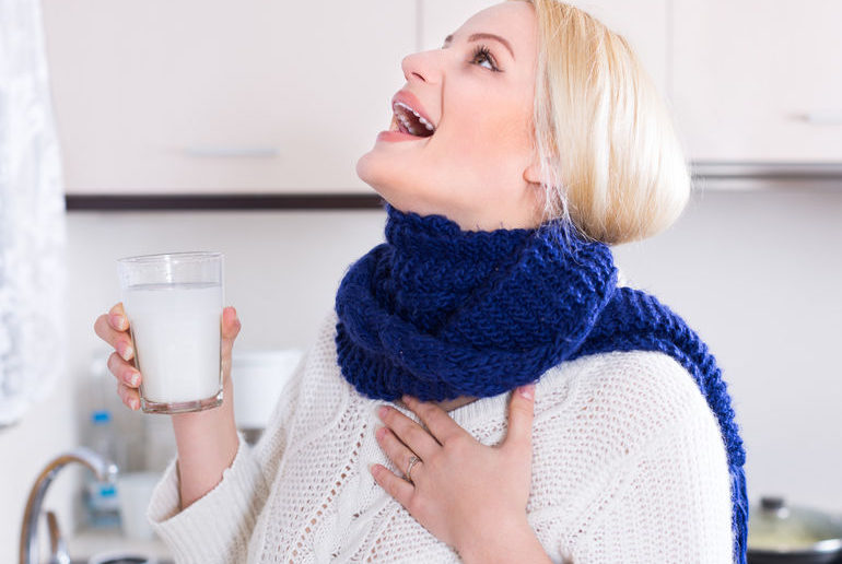 40827065 - blonde young woman having pain in throat and doing oral rinsing at kitchen