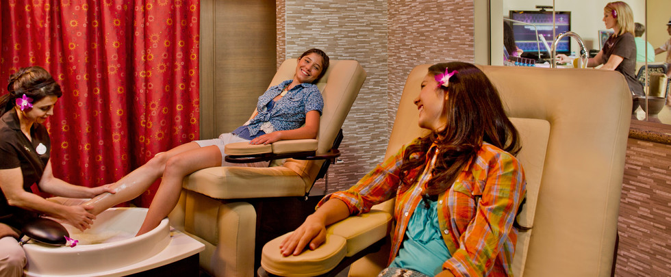 aulani-painted-sky-teen-spa-girls-getting-foot-massage-hero-g