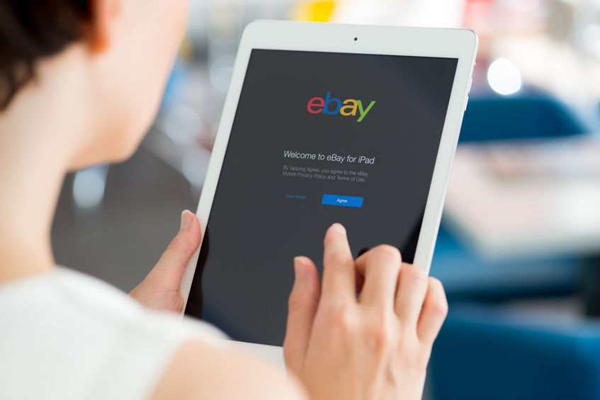 28691179 - kiev, ukraine - may 21, 2014: woman holding a white apple ipad air with ebay welcome message on a screen. ebay is the worldwide online auction and shopping website that founded in september 3, 1995.