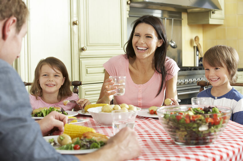 42251501 - family eating meal together in kitchen