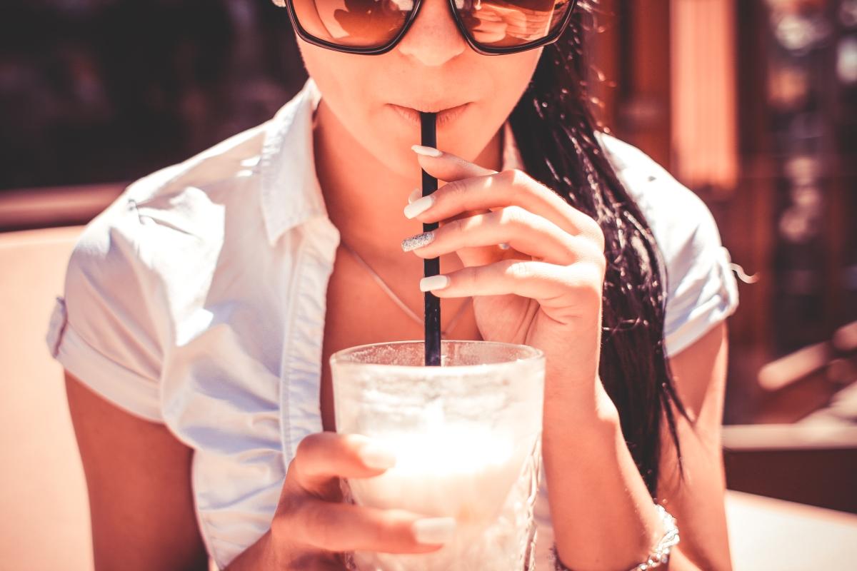 optimized-a-girl-drinking-milkshake-drink-in-caffe-picjumbo-com