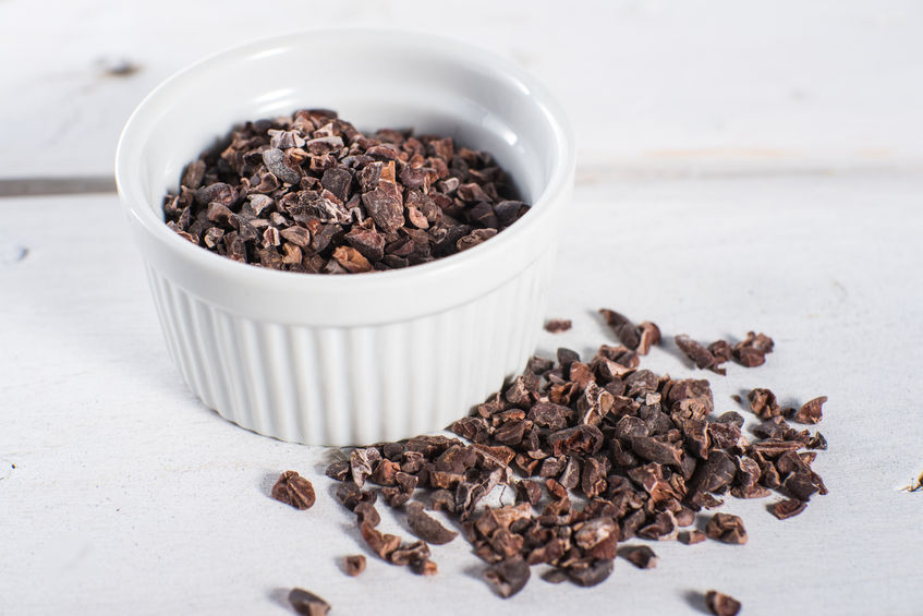 36476237 - bowl of chocolate cacao nibs on white background