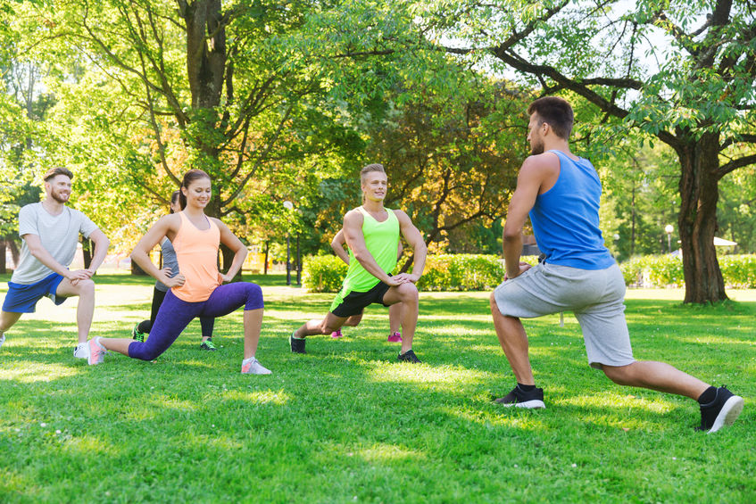 48512430 - fitness, sport, friendship and healthy lifestyle concept - group of happy teenage friends or sportsmen exercising and doing lunge at boot camp