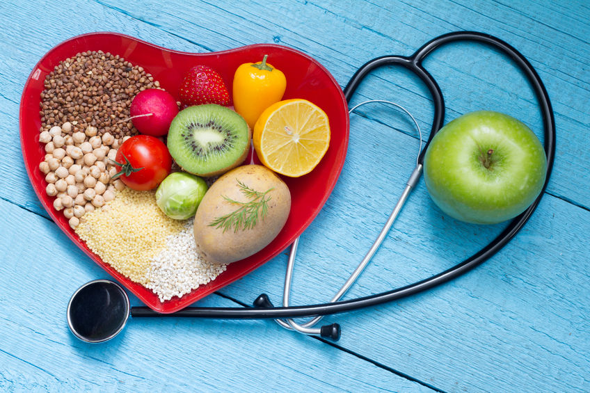 51114373 - food on heart plate with stethoscope cardiology concept