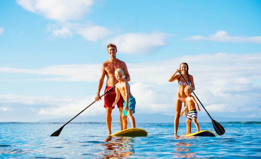 46094761 - family having fun stand up paddling together in the ocean on beautiful sunny morning